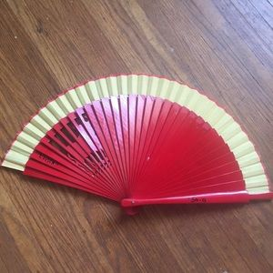Accessories - Red plastic hand fan with bull cut out from Spain
